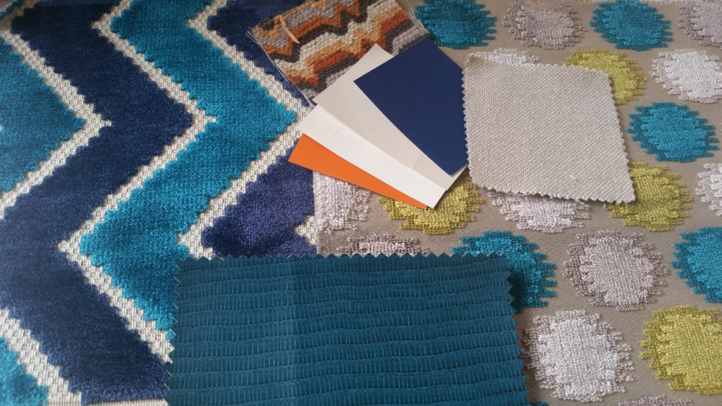 Fabrics of the Accent Pillows, sofas & bench seat. Paint swatches of other tones in the space