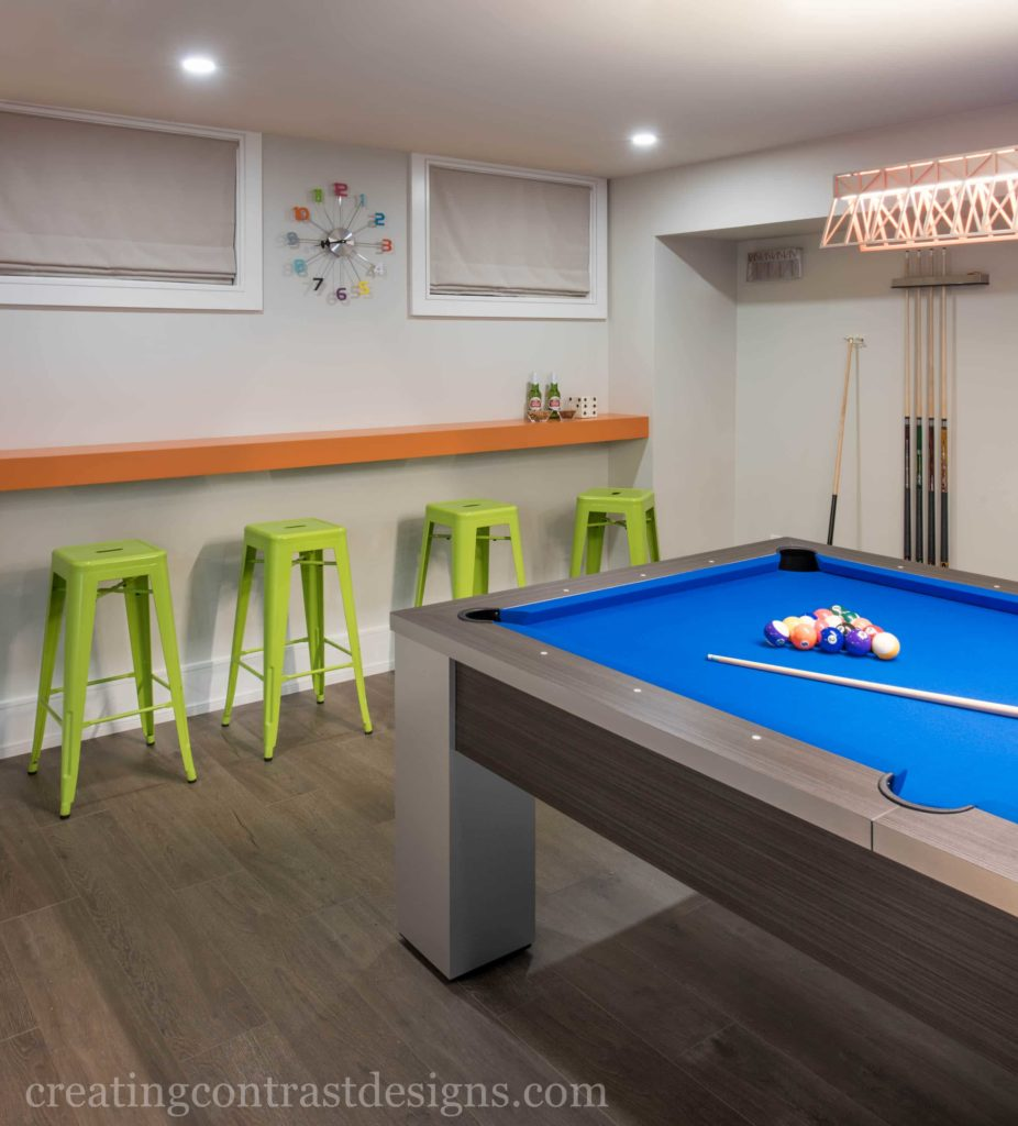 Oranges and Lime Green brighten up this pool table area of the basement