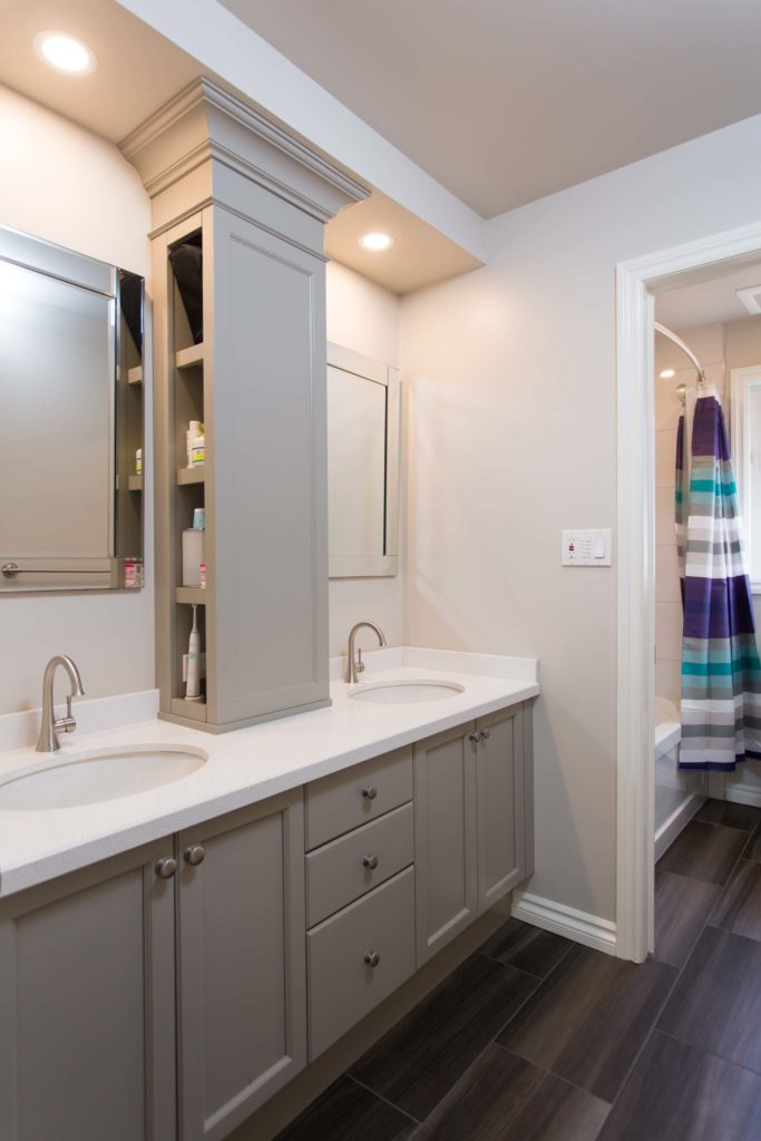 Updated Bathroom with soft Greys and White Quartz Countertop