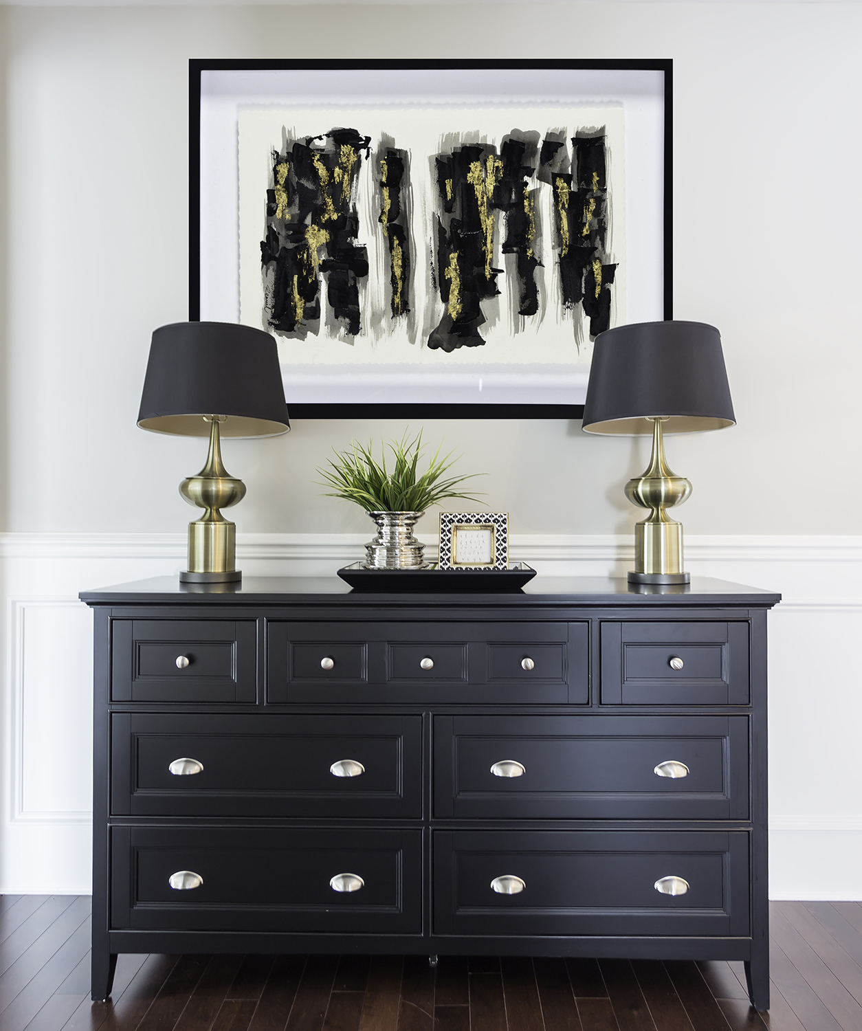 Foyer painted in Stonington Gray with striking black dresser and lamps.