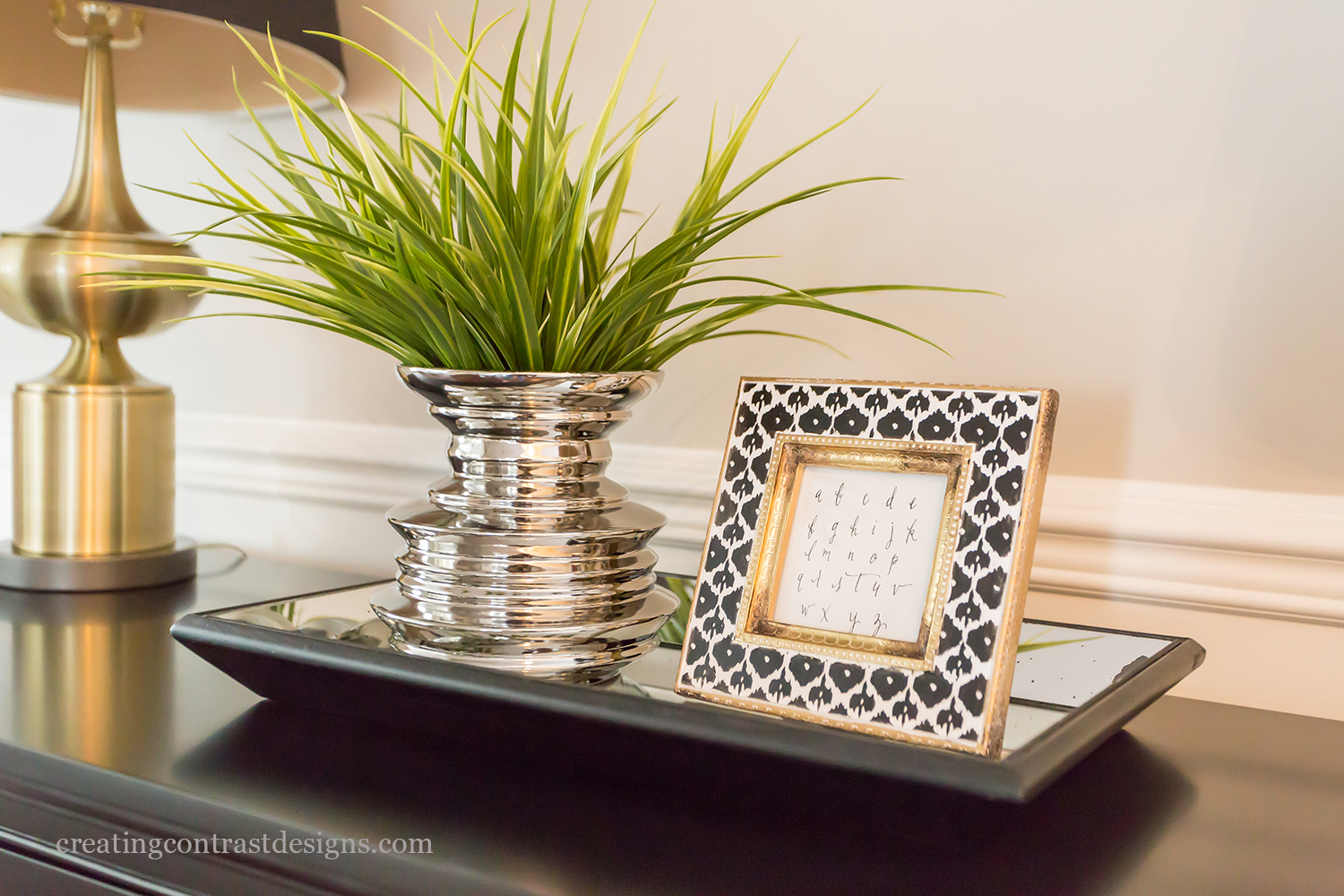 Vignette on dresser with gold accents.