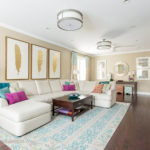 Living Room With Hardwood Flooring Teal And White Rug And Sectional