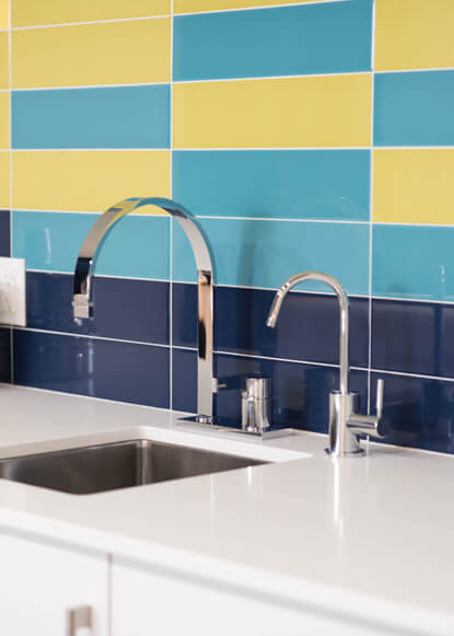 basement-backsplash-with-blue-and-yellow-subway-tiles