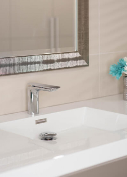 basement-bathroom-with-taps-sink-and-chrome-faucet-with-silver-mirror