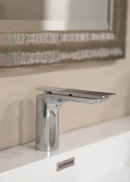 basement-bathroom-with-taps-sink-and-chrome-faucet-with-silver-mirror-and-eden-tile-backsplash