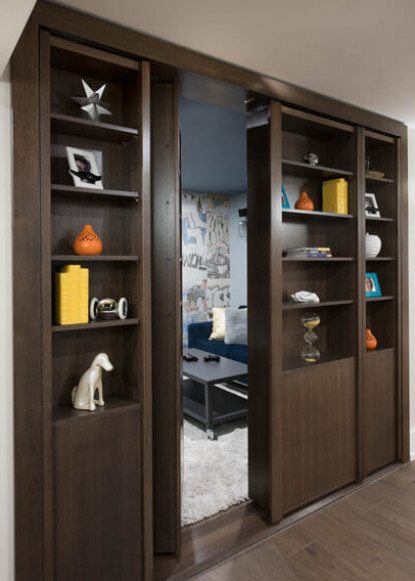 basement-bookcase-with-hidden-door-opening-and-open-shelving