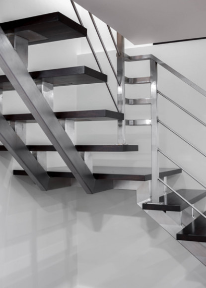 basement-close-up-of-stairs-with-open-risers-and-metal-details