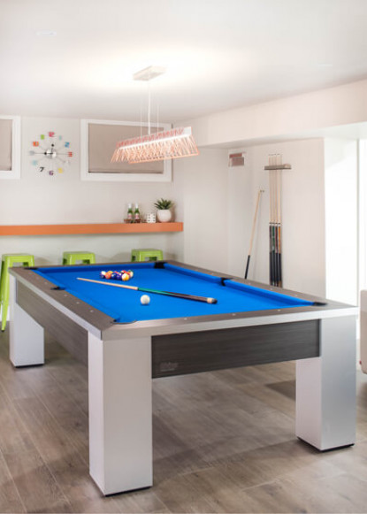 basement-game-area-with-blue-pool-table-and-green-and-orange-bar-seating