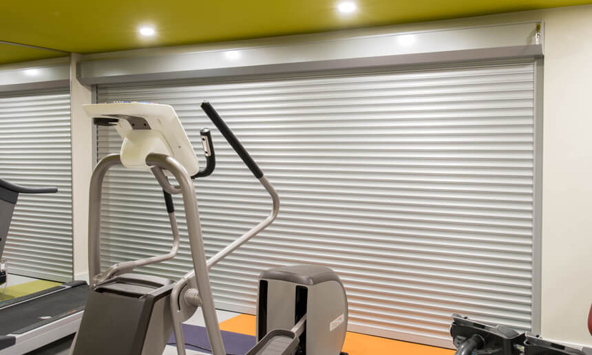 basement-gym-with-metal-door-covering-electrical-and-gym-equiptment