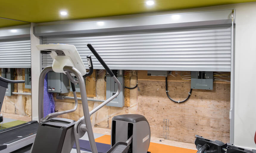 basement-gym-with-metal-door-open-showing-electrical