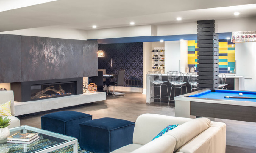 basement-living-room-with-bar-and-pool-table-and-poker-area