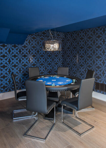basement-poker-table-with-blue-ceiling-and-patterned-wallpaper