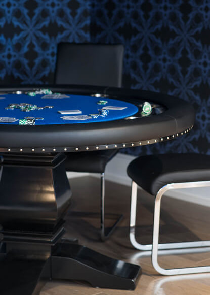 basement-poker-table-with-blue-tabletop-and-wall-paper