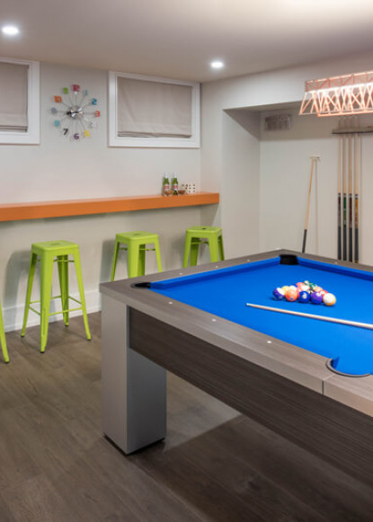 basement-pool-table-with-green-and-orange-bar-seating-2