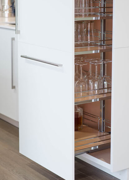 basement-pull-out-drawer-with-wine-storage-and-white-cabinets