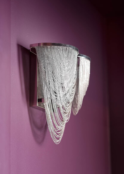 basement-purple-wall-with-crystal-sconce