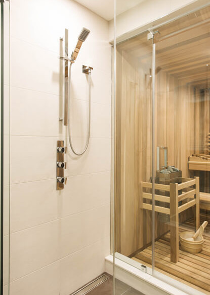 basement-sauna-with-modern-taps-handheld-shower-head