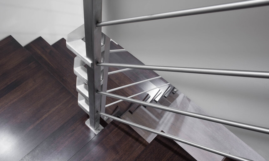 basement-staircase-with-stainless-steel-wrap-around-railing-and-wooden-steps