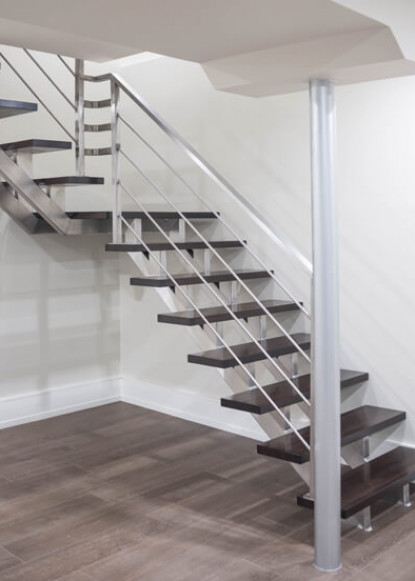 basement-staircase-with-wood-steps-and-modern-metal-railings
