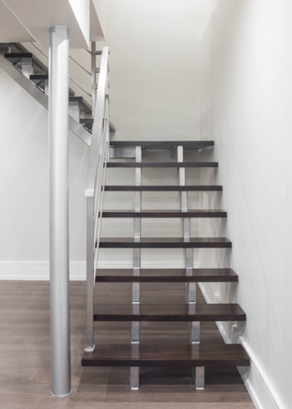 basement-stairs-with-open-risers-and-metal-railings
