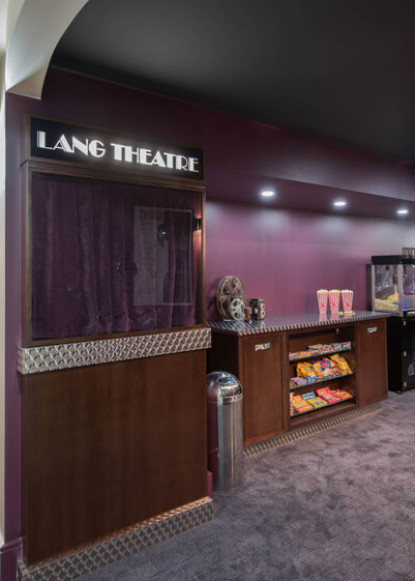 basement-theatre-ticket-booth-and-popcorn-station-with-purple-walls-and-carpet