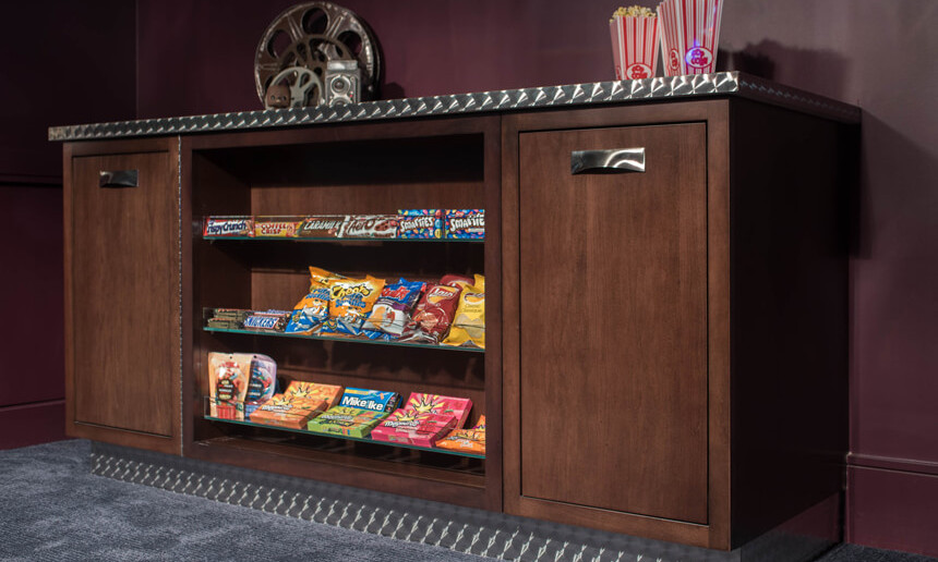 basement-theatre-with-custom-popcorn-and-candy-station