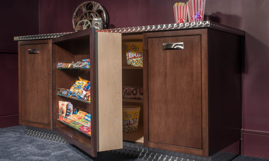 basement-theatre-with-custom-popcorn-and-candy-station-with-hidden-storage