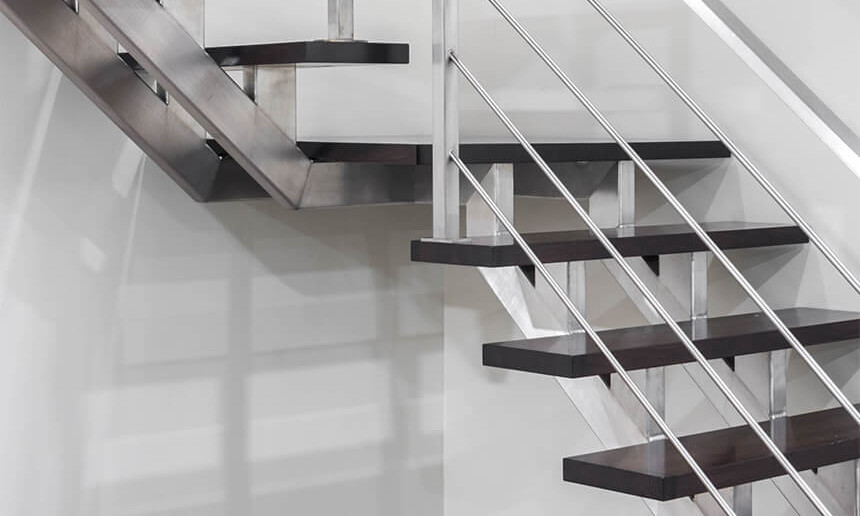 basment-staircase-with-wood-steps-and-metal-railing
