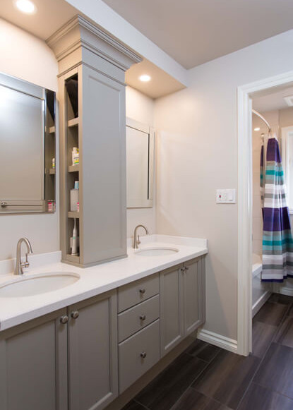 bathroom-with-hidden-storage-and-custom-cabinetry-painted-benjamin-moore-paint-and-dark-tile-flooring-and-round-potlights-and-silver-square-mirrors