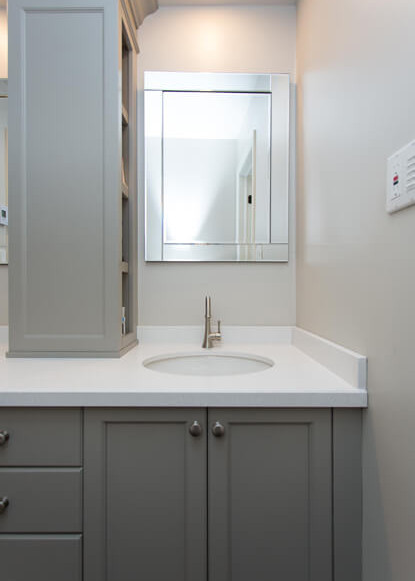 benjamin-moore-painted-custom-cabinets-with-hidden-storage-and-bevelled-mirror-in-traditional-modern-bathroom