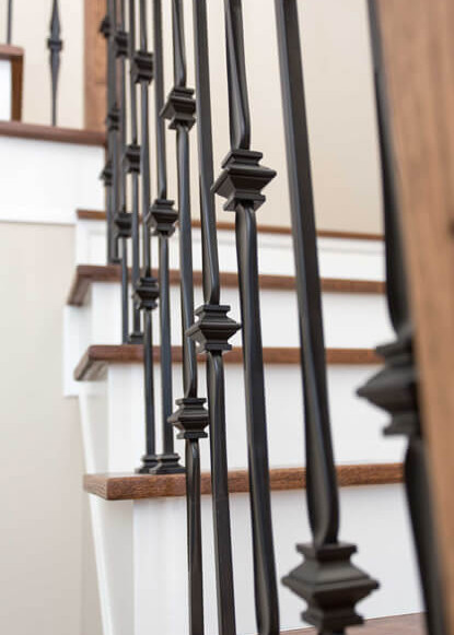 close-up-detail-of-stairway-with-wooden-steps-and-black-railing-details