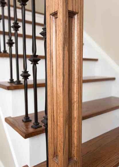 custom-railing-in-front-foyer-stair-way-and-wooden-stairs