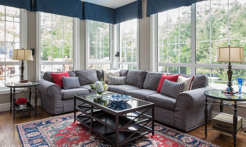 dark-blue-window-treatment-roman-blinds-in-living-room-with-grey-sectional