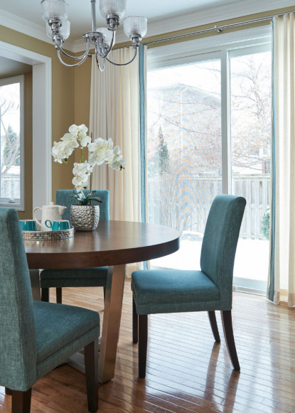 eat-in-kitchen-with-round-table-upholstered-chairs-and-hardwood-flooring