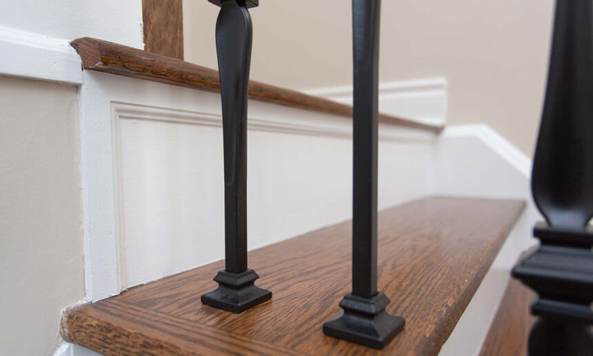 front-foyer-stair-details-and-wooden-steps-with-black-railing