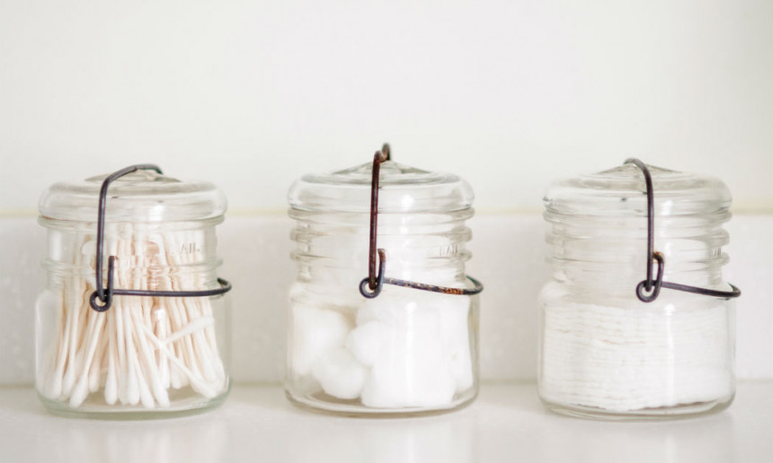 glass-jars-with-q-tips-and-cotton-balls-in-bathroom-design-with-white-countertops-2