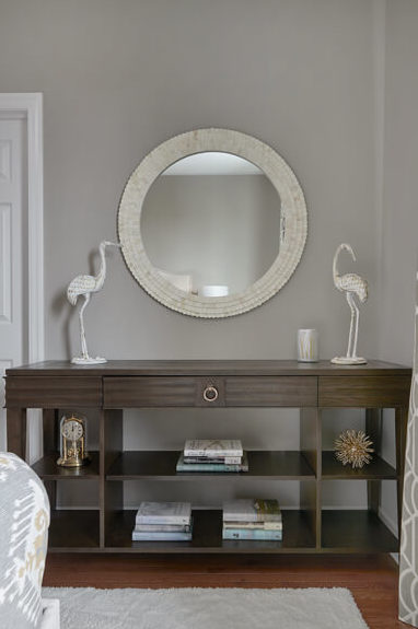 interiors_-bedroom-design-in-cosmopolitan-by-benjamin-moore-and-custom-console-with-round-mirror-and-cream-rug