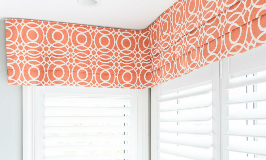 kitchen-banquette-with-pleated-valance-in-orange-geometric-and-white-shutters