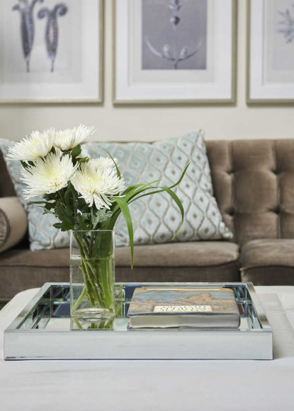 living-room-velvet-sofa-with-coffee-table-and-white-flowers-on-decorative-tray-jpg