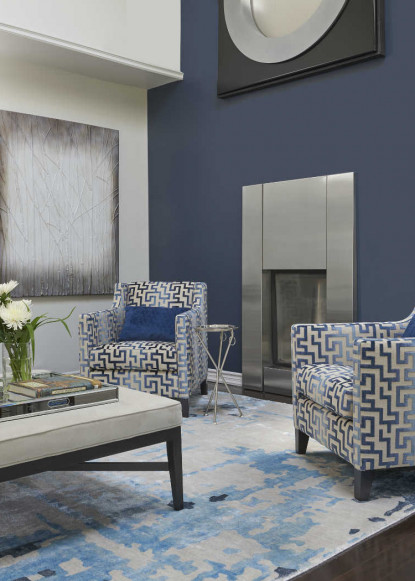 living-room-with-benjamin-moore-hale-navy-accent-wall-classic-gray-walls-fireplace-geometric-upholstered-chairs