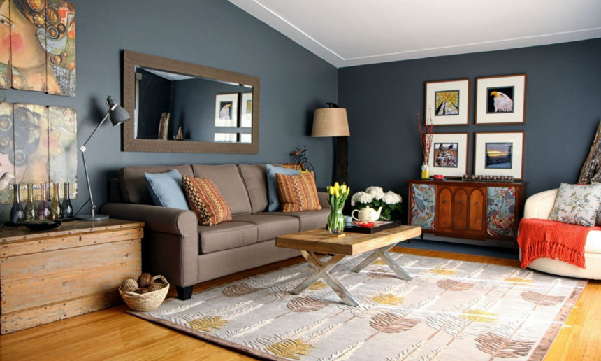living-room-with-area-rug-and-blue-walls-and-grey-sofa-and-contemporary-coffee-table-and-gallery-walls-2