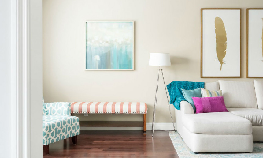 living-room-with-art-work-and-white-sectional-with-a-teal-rug-2