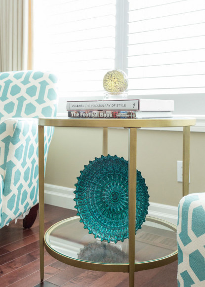 living-room-with-gold-side-table-and-teal-decor-table-books-2