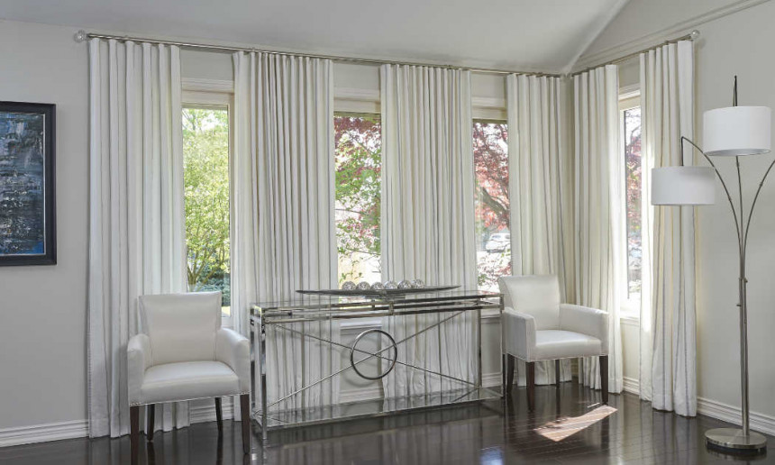 living-room-with-ripplefold-drapery-and-chrome-glass-table-with-white-side-chairs-and-tri-lamp-2