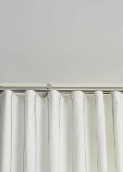 living-room-with-ripplefold-white-drapery-with-chrome-hardware