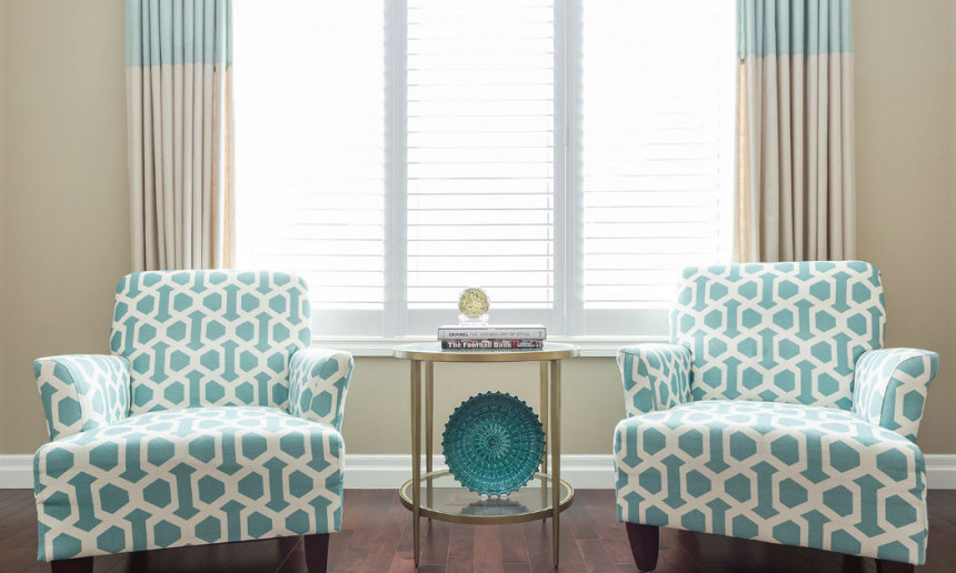 living-room-with-teal-and-white-geometric-patterned-fabric-chairs-ontario-interior-design