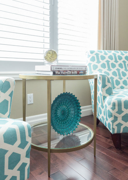 living-room-with-two-teal-and-white-side-chairs-and-side-table-with-teal-and-gold-decor-2