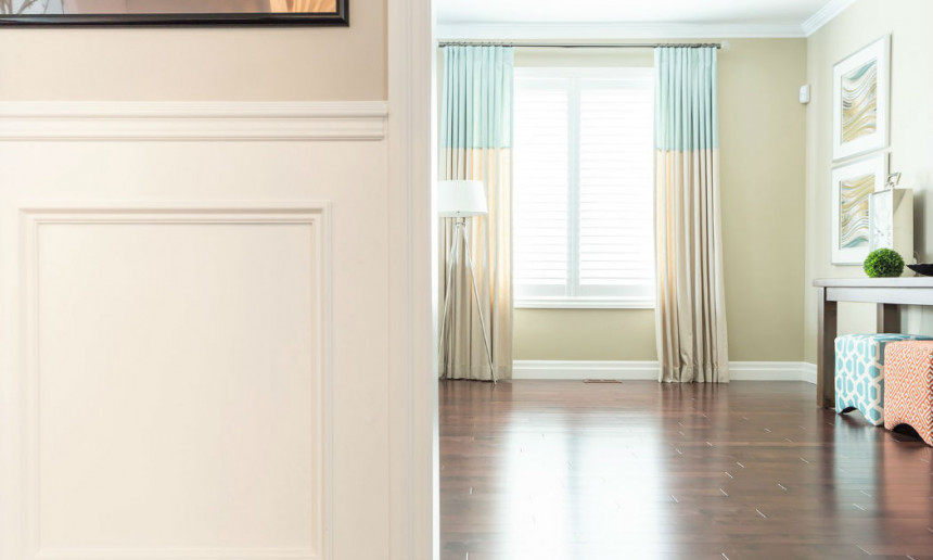 living-room-with-white-wainscoting-and-inverted-pleat-drapery