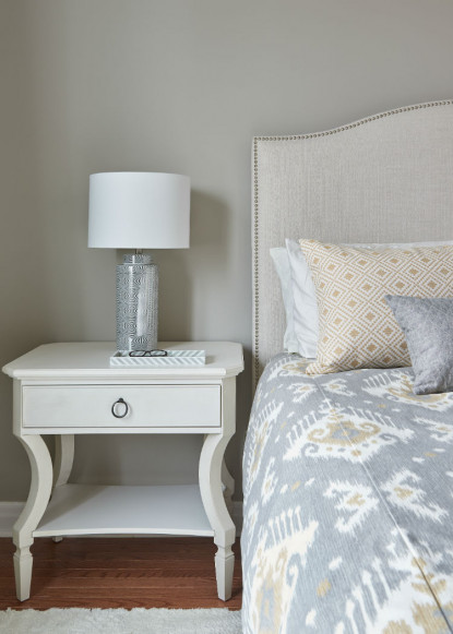 master-bedroom-with-nailhead-detailed-upholstered-head-board