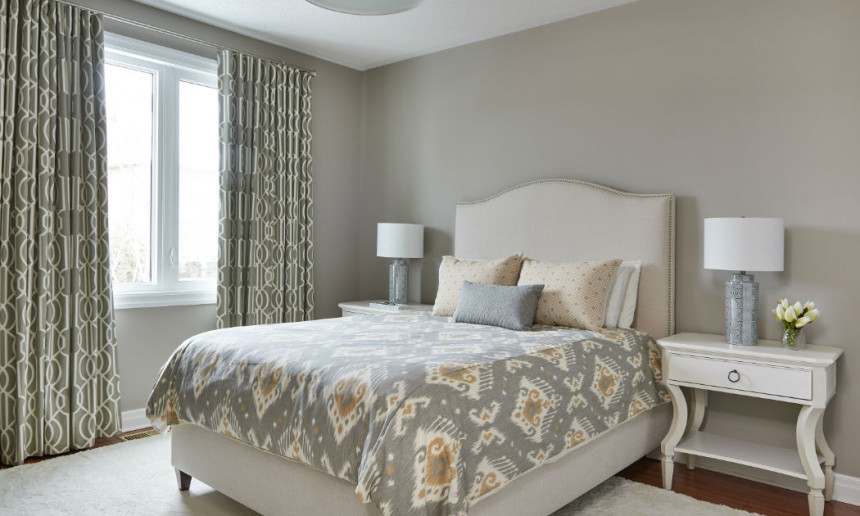 master-bedroom-with-upholstered-headboard-with-nailhead-trim